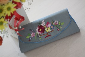 The Flowers 17 - SOLDMaterial : silkColour : silver with soft blue colour sides and liningLength : 32cm (lower) and 27cm (upper)Height : 12cmWidth : 6cm